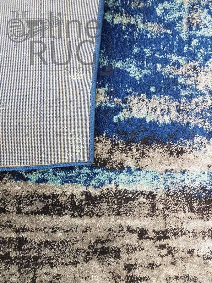 Awaken Blue Canvas Power Loomed Rug